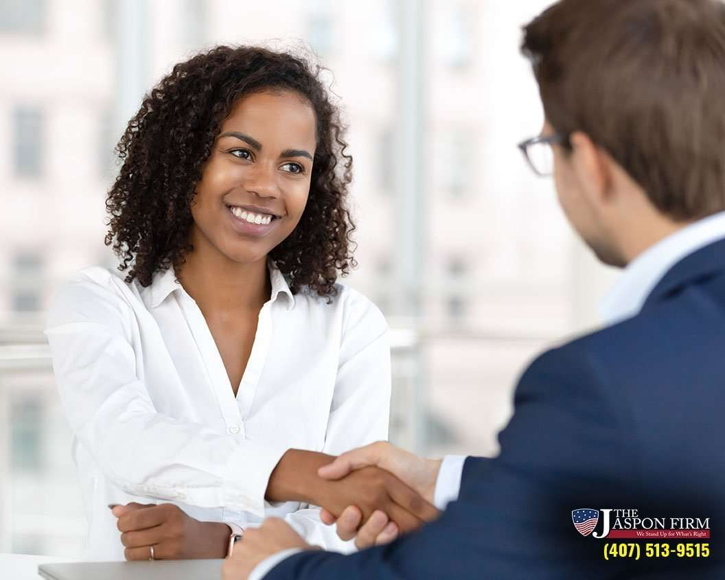 Photo of Attorney and Client Shaking Hands
